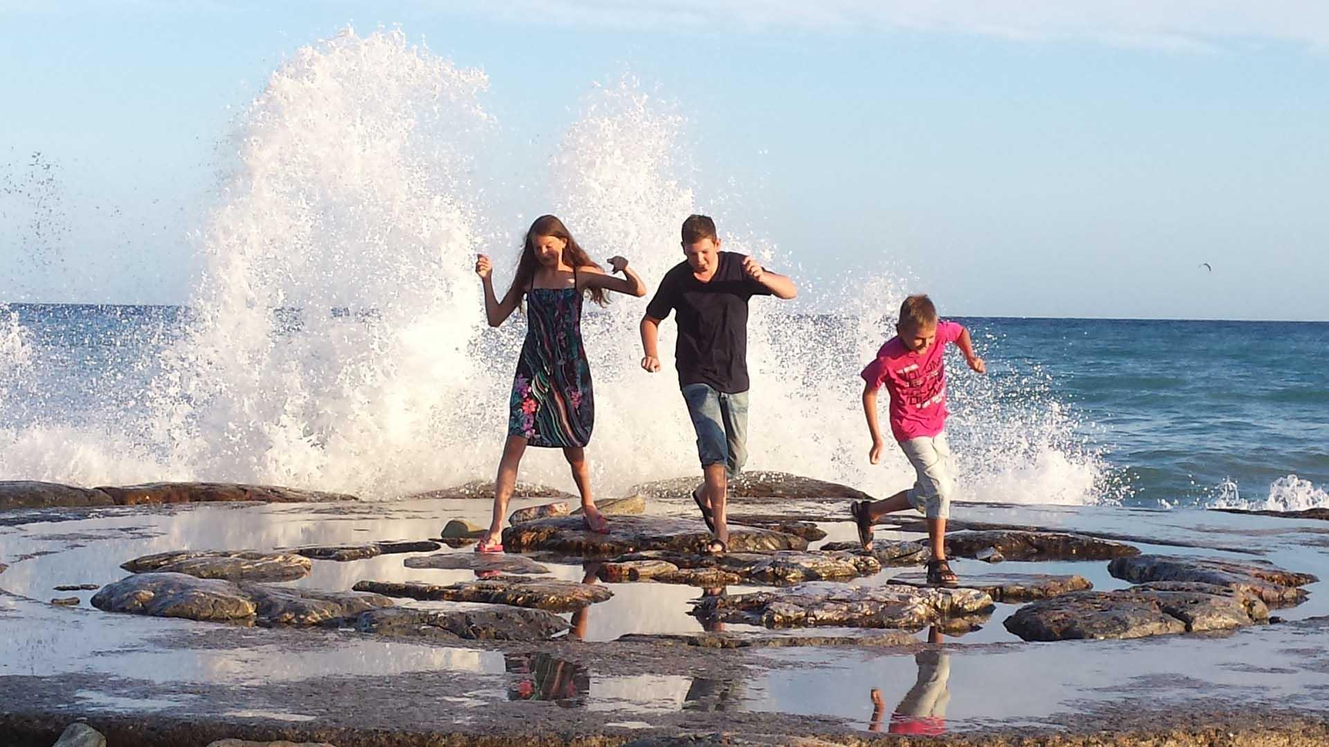 healthy kids running on rocks