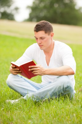 young-man-reading-book